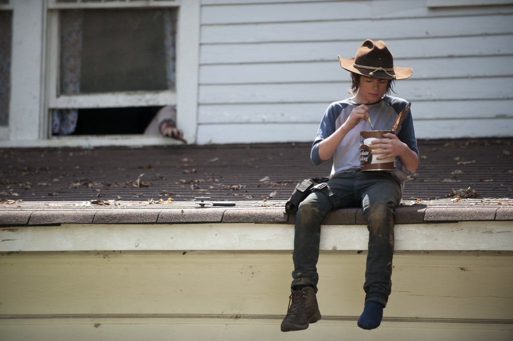 TWD does this kind of imagery right: a dirty child wearing a gun holster and only one shoe perches on the edge of a high roof, eating chocolate frosting directly from the can as a disembodied hand reaches for him. It's poignant and spooky all at once.